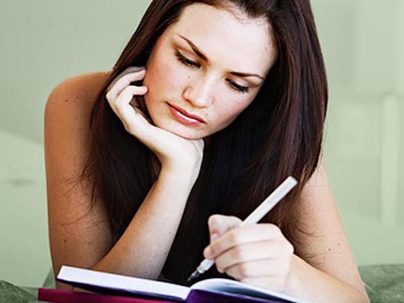 Sad-girl-holding-pen